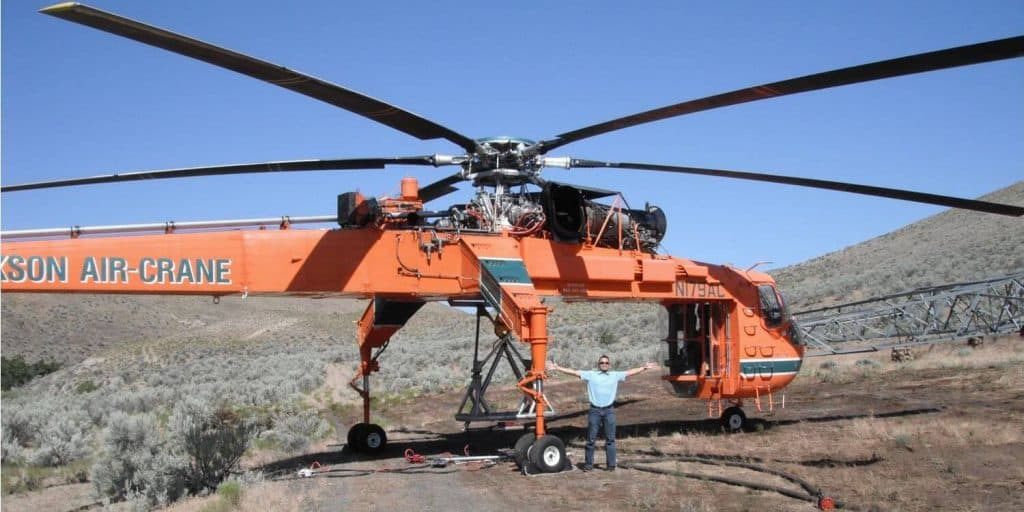 Marco Sison standing underneath an Erickson Air-Crane