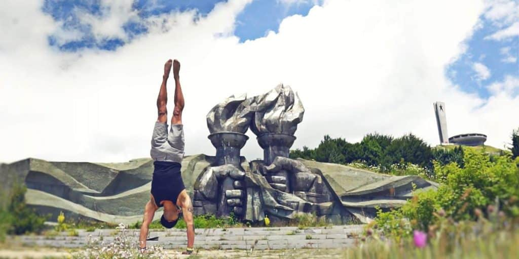Marco Sison doing a handstand in front of the UFO monument in Buzludzha, Bulgaria